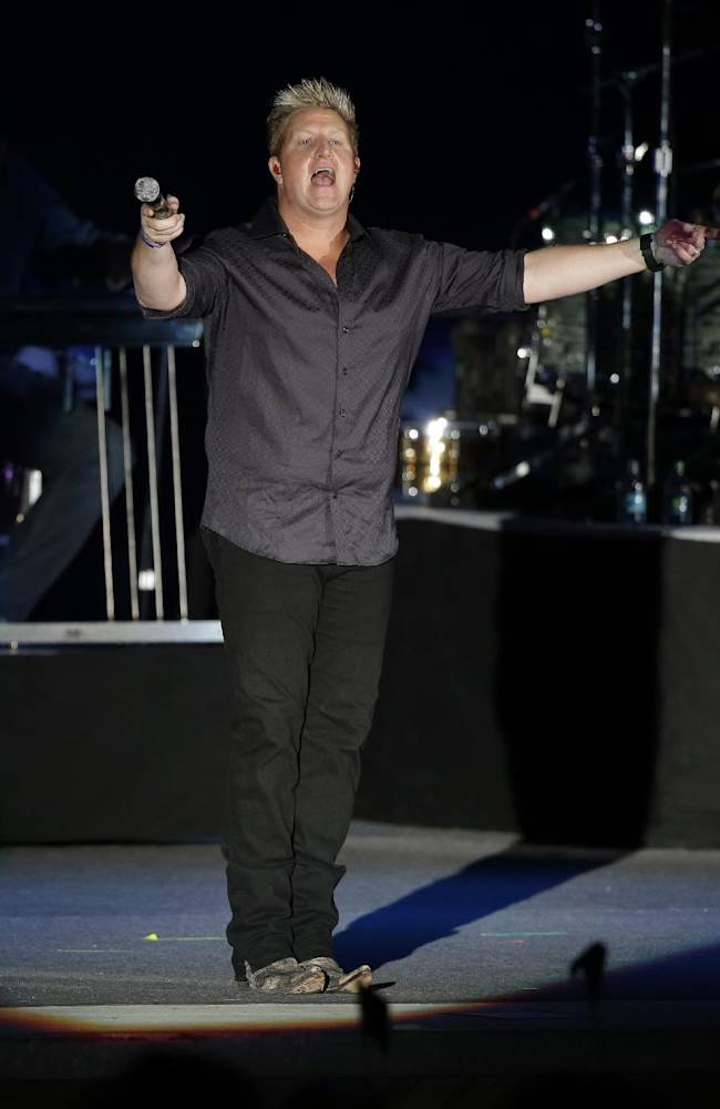 Gary LeVox of the country music group Rascal Flatts sings during the opening ceremony for the Presidents Cup golf tournament, Wednesday, Oct. 2, 2013, in Columbus, Ohio