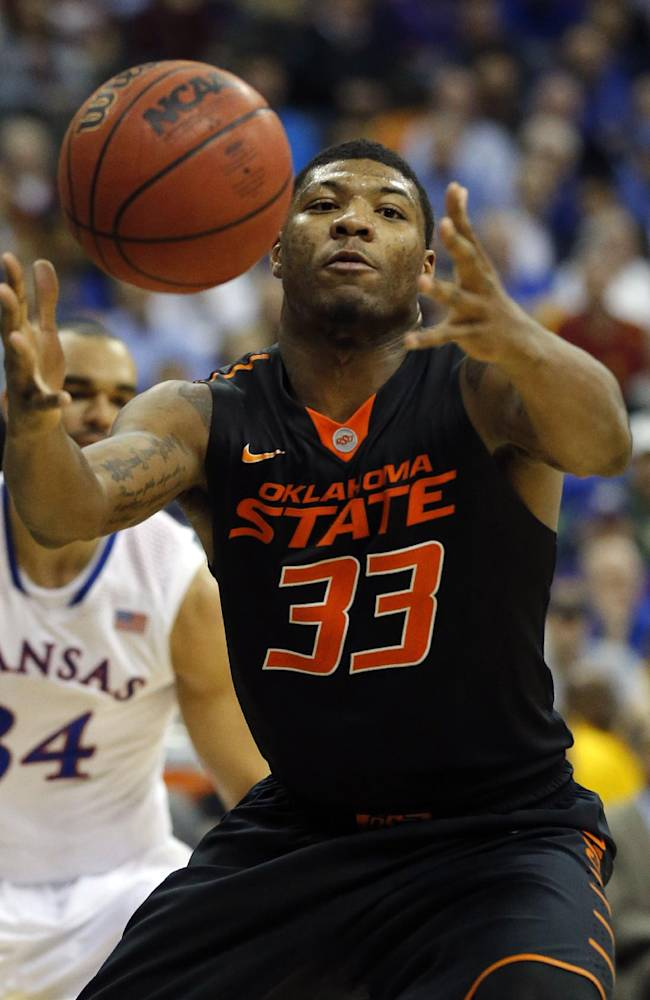 In this March 13, 2014 file photo, Oklahoma State guard Marcus Smart (33) reaches for the ball during the second half of an NCAA college basketball game against Kansas in the quarterfinals of the Big 12 Conference men's tournament in Kansas City, Mo.  Oklahoma State (21-12), the No. 9 seed in the West Region, will play No. 8 seed Gonzaga (28-6) Friday, March 21, 2014, in San Diego in its NCAA tournament opener. This will be Smart's last shot at tournament success because he will enter the NBA Draft after this season