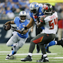 Detroit Lions running back Reggie Bush runs during the first half of an NFL football game against the Tampa Bay Buccaneers in Detroit, Sunday, Dec. 7, 2014 The Associated Press