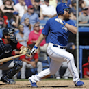 Toronto Blue Jays Adam Lind follows through on an RBI double to center field that scored Edwin Encarnacion during the fourth inning of a spring training baseball game against the Minnesota Twins in Dunedin, Fla., Saturday, March 8, 2014 The Associated Pre