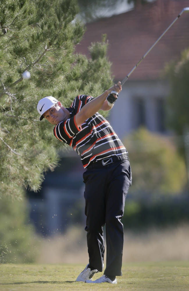 Nick Watney hits an approach shot off the 16th fairway in the first round of the Shriners Hospitals for Children Open golf tournament, Thursday, Oct. 17, 2013, in Las Vegas