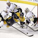 Nashville Predators forward Gabriel Bourque (57) falls as he is defended by Pittsburgh Penguins center Tanner Glass (15) and goalie Marc-Andre Fleury (29) in the third period of an NHL hockey game Tuesday, March 4, 2014, in Nashville, Tenn. The Penguins w