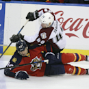 Florida Panthers' Erik Gudbranson (44) and Colorado Avalance's Alex Tanguay (40) battle for the puck during the third period of an NHL hockey game, Thursday, Jan. 15, 2015 in Sunrise, Fla. The Avalanche won 4-2 The Associated Press