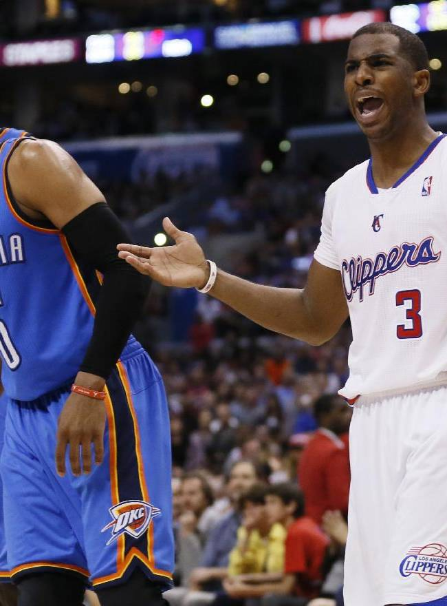 Los Angeles Clippers guard Chris Paul, right, reacts as he is called for a foul on Oklahoma City Thunder guard Russell Westbrook, left, during the second half of an NBA basketball game in Los Angeles, Wednesday, April 9, 2014. The Thunder won 107-101