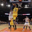 Indiana Pacers center Ian Mahinmi (28) knocks the ball from New York Knicks forward Carmelo Anthony (7) in the second half of Game 1 of their NBA basketball playoff series in the Eastern Conference semifinals at Madison Square Garden in New York, Sunday, May 5, 2013. The Pacers won 102-95. (AP Photo/Kathy Willens)