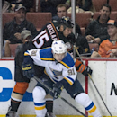 In this Sunday, Oct. 19, 2014, photo, Anaheim Ducks' Ryan Getzlaf battles Vladimir Tarasenko, of Russia, for the puck during an NHL hockey game in Anahein, Calif The Associated Press