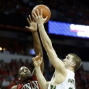 Colorado State's Pierce Hornung (4) shoots over UNLV's Quintrell Thomas (1) during the first half of a Mountain West Conference tournament NCAA college basketball game on Friday, March 15, 2013, in Las Vegas. (AP Photo/Isaac Brekken)