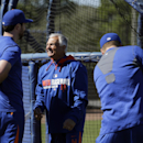 New York Mets manager Terry Collins, center, talks with Ike Davis, left, as Davis and Lucas Duda, right, prepare to take batting practice during spring training baseball practice Friday, Feb. 14, 2014, in Port St. Lucie, Fla The Associated Press