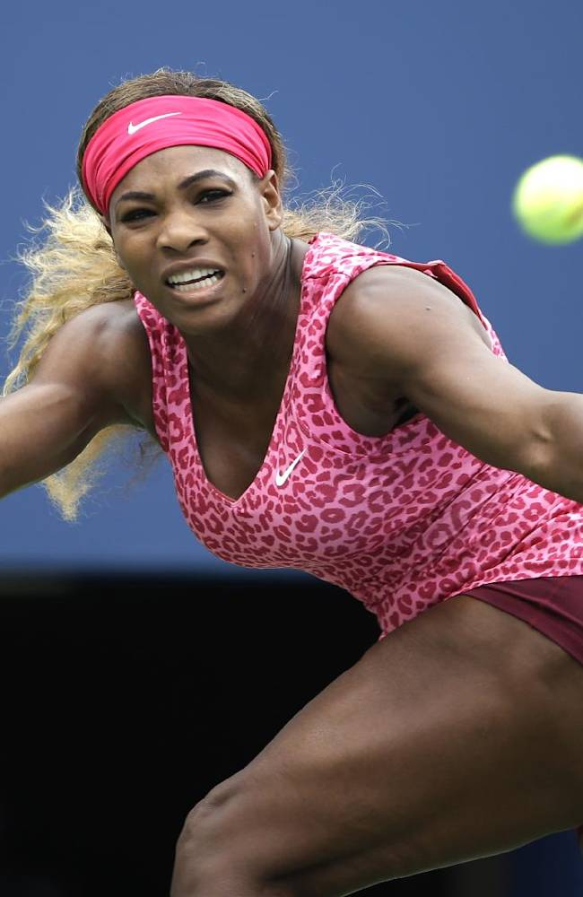 Serena Williams, of the United States, returns a shot against Varvara Lepchenko, of the United States, during the third round of the 2014 U.S. Open tennis tournament, Saturday, Aug. 30, 2014, in New York