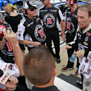 Kevin Harvick, right, talks with team members after setting a new track record during qualifying for the NASCAR Sprint Cup series auto race at Bristol Motor Speedway on Friday, Aug. 22, 2014, in Bristol, Tenn. Harvick won the pole. (AP Photo/Wade Payne)