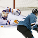 Edmonton Oilers goalie Richard Bachman (30) is beaten for a goal on a shot from San Jose Sharks center Patrick Marleau (12) during the third period of an NHL hockey game Tuesday, April 1, 2014, in San Jose, Calif. San Jose won 5-4 The Associated Press