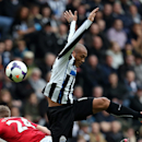 Manchester United's Darren Fletcher, left, vies for the ball with Newcastle United's Yoan Gouffran, right, during their English Premier League soccer match at St James' Park, Newcastle, England, Saturday, April 5, 2014
