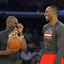 Los Angeles Lakers guard Jodie Meeks, left, talks with Houston Rockets center Dwight Howard prior to an NBA basketball game, Wednesday, Feb. 19, 2014, in Los Angeles The Associated Press