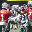 Vick embracing role as mentor to Smith with Jets The Associated Press
