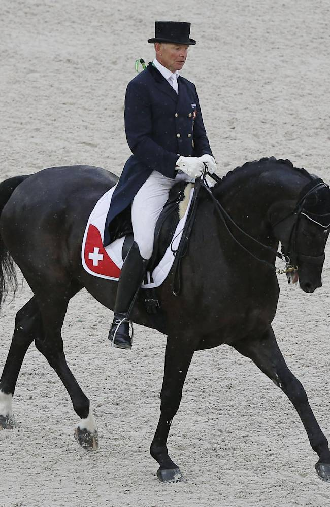 Hans Staub of Switzerland, riding Warbeau during the first day of Dressage team competition at the FEI World Equestrian Games, at Michel d'Ornano stadium in Cean, western France, Monday, Aug. 25, 2014