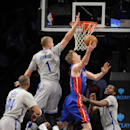 Brooklyn Nets' Paul Pierce (34), Mason Plumlee (1) and Joe Johnson (7) block the shot of Detroit Pistons' Kyle Singler in the first half of an NBA basketball game on Friday, April 4, 2014, in New York The Associated Press