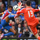 10ThingstoSeeSports - Crystal Palace's Fraizer Campbell, left, competes for the ball with Chelsea's Thibaut Courtois during their English Premier League soccer match at Selhurst Park, London, Saturday, Oct. 18, 2014