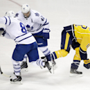 Nashville Predators forward Mike Fisher (12) moves the puck past Toronto Maple Leafs defenseman Petter Granberg (8), of Sweden, and center Tyler Bozak (42) in the first period of an NHL hockey game Tuesday, Feb. 3, 2015, in Nashville, Tenn The Associated