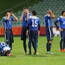 US team players react after their loss to Serbia in a penalty shoot out during their U20 soccer World Cup quarterfinal game in Auckland, New Zealand, Sunday, June 14, 2015. (AP Photo/David Rowland)