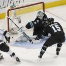 San Jose Sharks goalie Antti Niemi (31), of Finland, blocks a goal attempt against Los Angeles Kings left wing Dustin Penner (25) as San Jose Sharks center James Sheppard (15) defends during the third period in Game 3 of their second-round NHL hockey Stanley Cup playoff series, Saturday, May 18, 2013, in San Jose, Calif. (AP Photo/Tony Avelar)
