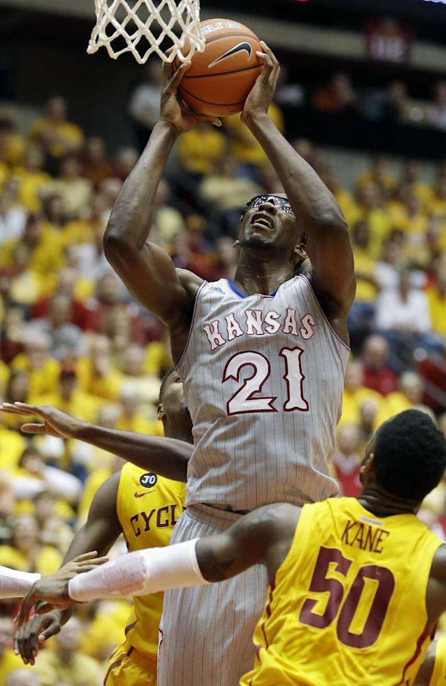 Kansas center Joel Embiid (21) shoots over Iowa State guard DeAndre Kane (50) during the second half of an NCAA college basketball game, Monday, Jan. 13, 2014, in Ames, Iowa. Kansas won 77-70