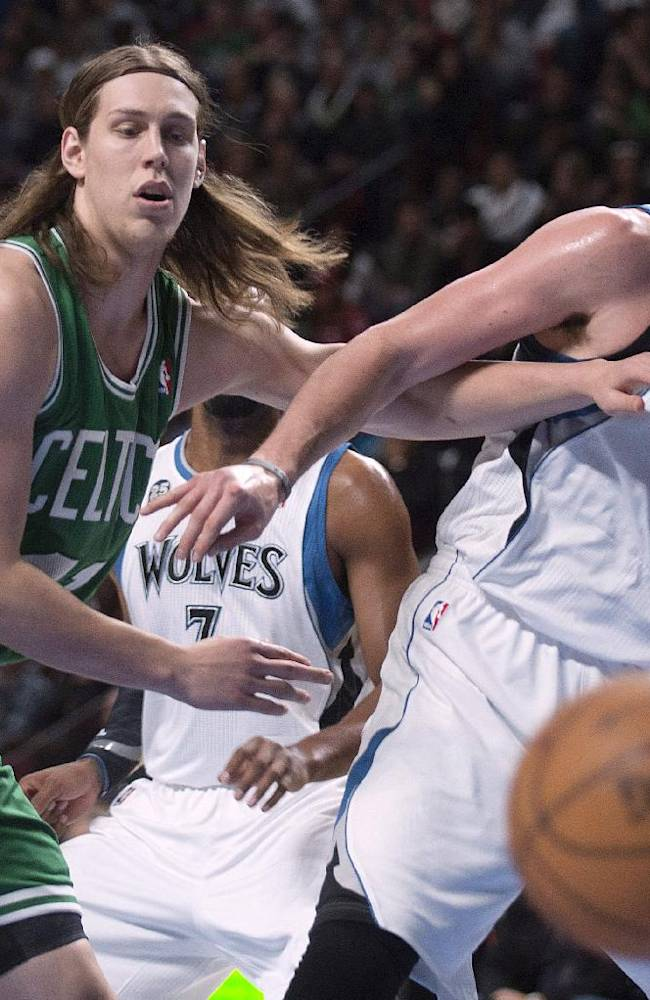 Minnesota Timberwolves' Kevin Love, right, and Boston Celtics' Kelly Olynyk keep their eyes on the ball during the first quarter of an NBA preseason basketball game in Montreal, Sunday, Oct. 20, 2013