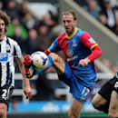 Crystal Palace's Glenn Murray, center, vies for the ball with Newcastle United's captain Fabricio Coloccini, left, and Mike Williamson, right, during their English Premier League soccer match at St James' Park, Newcastle, England, Saturday, March 22, 2014