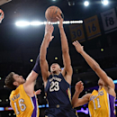 Anthony Davis #23 of the New Orleans Pelicans shoots against Pau Gasol #16 and Wesley Johnson #11 of the Los Angeles Lakers at Staples Center on March 4, 2014 in Los Angeles, California. (Photo by Noah Graham/NBAE via Getty Images)