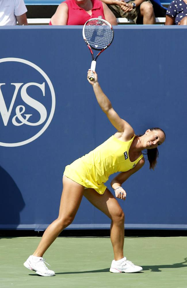 Jelena Jankovic, from Serbia, reacts during a match with Sloane Stephens at the Western & Southern Open tennis tournament, Thursday, Aug. 14, 2014, in Mason, Ohio