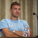 Manchester City Football Club striker Edin Dzeko listens to a reporter's question during a news conference in New York, Tuesday, July 29, 2014, in advance of Wednesday's Guinness International Champions Cup soccer match against rival Liverpool