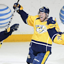 Nashville Predators forward Patric Hornqvist (27), of Sweden, celebrates with Shea Weber (6) and forward Mike Fisher (12) after Hornqvist scored the go ahead goal against the Tampa Bay Lightning in the third period of an NHL hockey game, Thursday, Feb. 27
