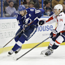 Tampa Bay Lightning center Steven Stamkos (91) carries the puck around Washington Capitals defenseman John Carlson (74) during the second period of an NHL hockey game Tuesday, Dec. 9, 2014, in Tampa, Fla The Associated Press