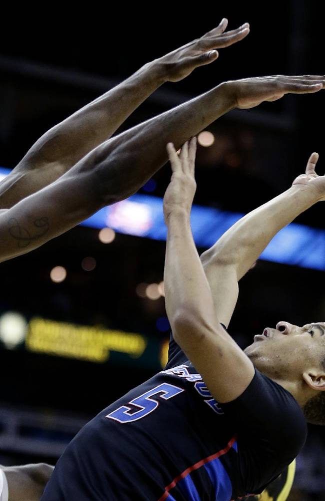 In this Nov. 25, 2013 file photo, Wichita State's Kadeem Coleby, left, blocks a shot by DePaul's Billy Garrett Jr. (5) during the second half of an NCAA college basketball game in Kansas City, Mo. Three teams from Kansas are ranked, led by No. 6 Wichita State. Maybe it's time to forget about Tobacco Road for a moment and look toward the Sunflower State