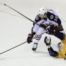 Columbus Blue Jackets defenseman David Savard (58) tries to get control of the puck as he defended by Nashville Predators center Mike Fisher, right, in front of the Blue Jackets net in the third period of an NHL hockey game Saturday, Nov. 29, 2014, in Nas
