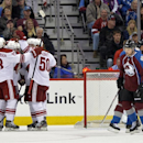 Colorado Avalanche center John Mitchell (7) reacts as Phoenix Coyotes defenseman Oliver Ekman-Larsson (23), Keith Yandle (3), Shane Doan (19) and Antoine Vermette (50) celebrate a Doan goal against Avalanche goalie Semyon Varlamov, right, during the first