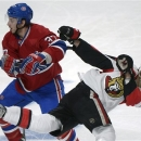 Ottawa Senators' Erik Karlsson, right, collides with Montreal Canadiens' Gabriel Dumont during third-period NHL hockey Game 2