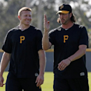 Pittsburgh Pirates pitchers Mark Melancon, left, and Jason Grilli, right, walk in the outfield after running sprints during an informal workout at Pirates City in Bradenton, Fla., Wednesday, Feb. 12, 2014. The first official day of baseball spring traini