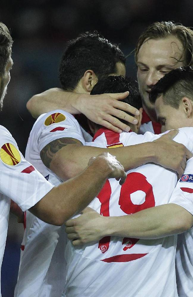 Sevilla's Jose Antonio Reyes, no, 19, is congratulated by team mates after he scored against Maribor during their Europa League round of 32, 2nd leg soccer match at the Ramon Sanchez Pizjuan stadium in Seville, Spain Thursday Feb. 27, 2014