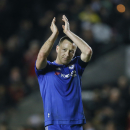 Chelsea's captain John Terry applauds the fans as he celebrates after the final whistle of the English FA Cup fourth round soccer match between Milton Keynes Dons and Chelsea at Stadium mk in Milton Keynes, England, Sunday, Jan. 31, 2016. Chelsea capt