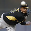 Pittsburgh Pirates starting pitcher Edinson Volquez (36) delivers a warm up pitch before facing the New York Yankees in a spring exhibition baseball game in Tampa, Fla., Friday, March 21, 2014 The Associated Press