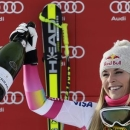 Lindsey Vonn of the U.S. celebrates with champagne on the podium after winning the women's World Cup Super-G skiing race in Cortina D'Ampezzo January 19, 2015.    REUTERS/Max Rossi