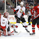 A shot by New Jersey Devils center Adam Henrique, not pictured, enters the net of Ottawa Senators goalie Robin Lehner (40), of Sweden, for a goal during the second period of an NHL hockey game, Tuesday, Feb. 3, 2015, in Newark, N.J. Senators' Jared Cowen