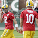 Green Bay Packers' Aaron Rodgers gestures to teammate Matt Flynn during NFL football training camp on Saturday, July 26, 2014, in Green Bay, Wis The Associated Press