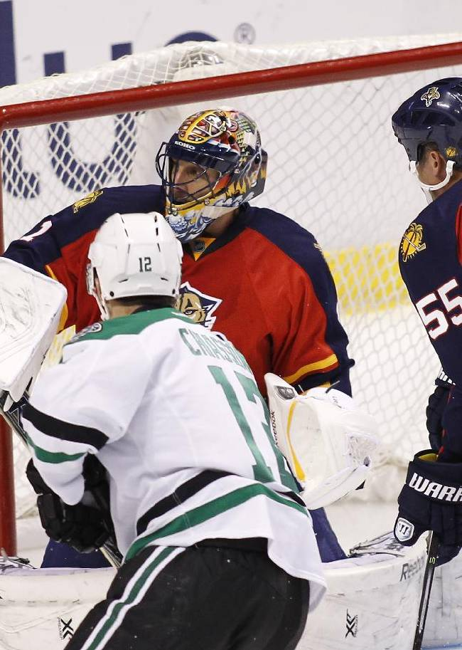 Florida Panthers goalie Roberto Luongo (1) blocks a shot as teammate  Ed Jovanovski (55) helps defend during the second period of an NHL hockey game against the Dallas Stars in Sunrise, Fla., Sunday, April 6, 2014
