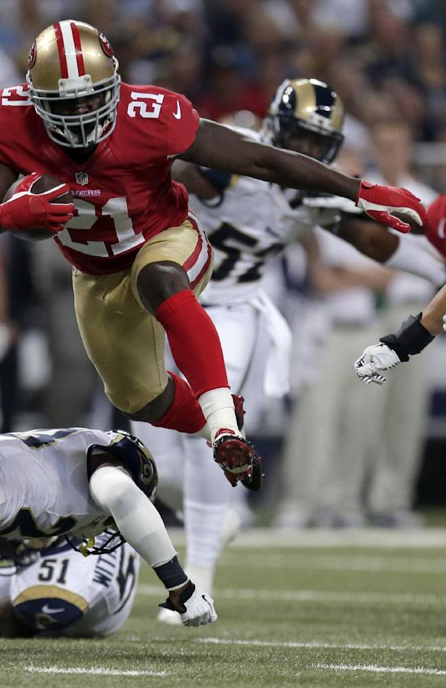 San Francisco 49ers running back Frank Gore (21) runs with the ball for an 18-yard gain during the first quarter of an NFL football game as St. Louis Rams linebacker James Laurinaitis, right, gives chase Thursday, Sept. 26, 2013, in St. Louis