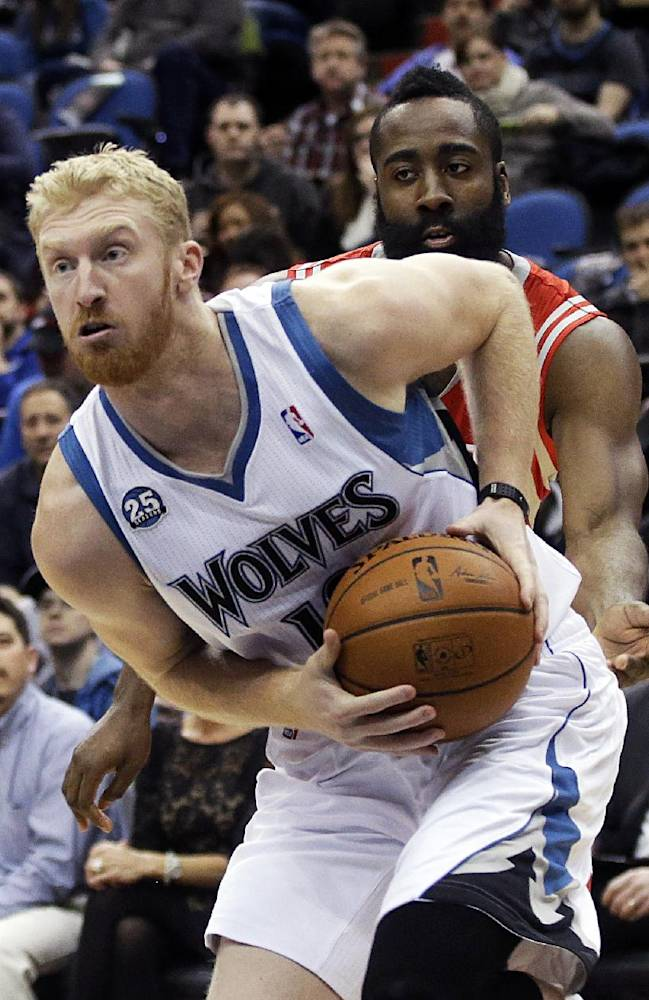 Minnesota Timberwolves' Chase Budinger, left, drives around Houston Rockets' James Harden in the first quarter of an NBA basketball game, Monday, Feb. 10, 2014, in Minneapolis