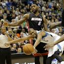 Minnesota Timberwolves forward Corey Brewer (13) loses control of the ball after colliding with Miami Heat forward LeBron James (6) during the third quarter of an NBA basketball game in Minneapolis, Saturday, Dec. 7, 2013. The Heat won 103-82. (AP Photo/Ann Heisenfelt)