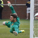 Manchester United goalkeeper David De Gea deflects a Real Madrid shot during a Guinness International Champions Cup soccer match at Michigan Stadium in Ann Arbor, Mich., Saturday, Aug. 2, 2014. Manchester United won 3-1. (AP Photo/Paul Sancya)