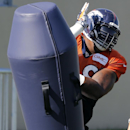Denver Broncos' Terrance Knighton runs a drill during NFL football training camp on Tuesday, Aug 12, 2014, in Englewood, Colo The Associated Press