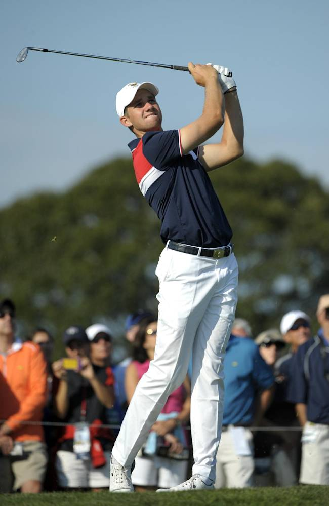 In this Sept. 8, 2013 file photo, Patrick Rodgers, of the United States team, tees off on the sixth hole during the second day of the Walker Cup golf tournament at National Golf Links of America in Southampton, N.Y. Rodgers, the No. 1 ranked amateur in the world, says he will forgo his final year of eligibility to pursue a professional career after this season. Rodgers said in a statement issued through the school Monday, March 3, 2014, that he announced his decision now because he doesn't want the growing speculation about his future to become a distraction for the team at Stanford
